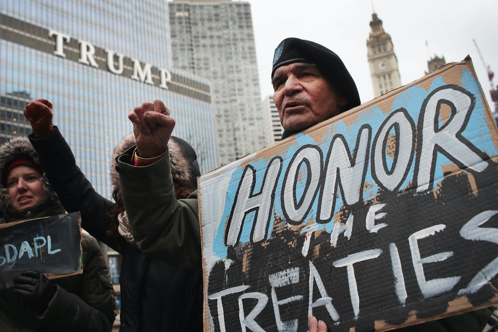 CHICAGO, IL - FEBRUARY 04:  Demonstrators rally near Trump Tower while protesting the construction of the Dakota Access pipeline on February 4, 2017 in Chicago, Illinois. President Donald Trump recently signed executive actions to advance approval of Dakota Access and the Keystone XL pipelines, undermining efforts by the administration of President Barack Obama to block their construction. (Photo by Scott Olson/Getty Images)