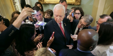 WASHINGTON, DC - AUGUST 01:  Sen. Orrin Hatch (R-UT) (C) is surrounded by reporters before heading into the Senate Republican policy luncheon at the U.S. Capitol August 1, 2017 in Washington, DC. After failing to pass legislation to repeal and replace the Affordable Care Act last week, Senate Republica are focused on a list of modest legislation and confirmations before heading into recess.  (Photo by Chip Somodevilla/Getty Images)