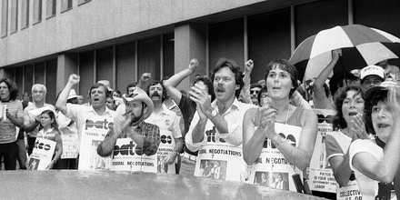 Striking air traffic controllers and sympathizers demonstrate outside of U.S. District Court in Brooklyn, New York, Wednesday, August 12, 1981. Robert Poli, the head of the striking flight controllers' union, appeared in the federal court, one day late to answer questions before a packed courtroom outside about 200 picketers carried PATCO signs. (AP Photo/Pickoff)