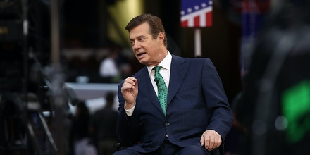 CLEVELAND, OH - JULY 17:  Paul Manafort, campaign manager for Republican presidential candidate Donald Trump, is interviewed on the floor of the Republican National Convention at the Quicken Loans Arena  July 17, 2016 in Cleveland, Ohio. The Republican National Convention begins tomorrow.  (Photo by Win McNamee/Getty Images)