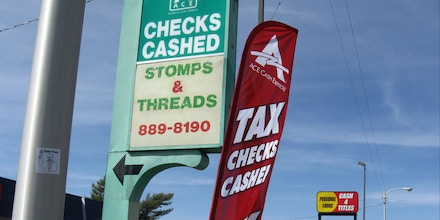 In this April 3, 2015 photo, an ACE Cash Express outlet is seen on San Mateo Boulevard in Albuquerque, N.M. The outlet sits on a block which has three small loan storefronts. High-interest lending practices have been a target of consumer advocates in New Mexico, one of the poorest states in the country, for decades. They struck out again this year in the Legislature as bills that would have capped interest rates on payday loans went nowhere. Efforts to reshape short-term loan laws have gained some traction in other states, leading some advocates to question whether campaign donations are swaying New Mexico's politicians. (AP Photo/Vik Jolly)