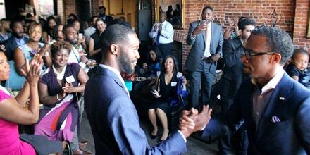 Randall Woodfin greets attendees during a fundraising reception at Smith Commons this summer.