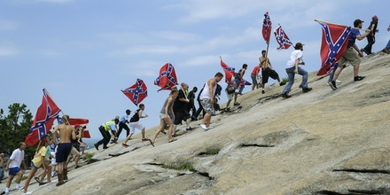 Confederate flag supporters climb Stone Mountain to protest of what they believe is an attack on their Southern heritage during a rally at Stone Mountain Park in Stone Mountain, Ga., on Saturday, Aug. 1, 2015. (John Amis/Atlanta Journal-Constitution via AP) MARIETTA DAILY OUT; GWINNETT DAILY POST OUT; LOCAL TELEVISION OUT; WXIA-TV OUT; WGCL-TV OUT