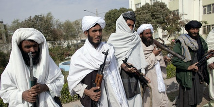 HERAT, AFGHANISTAN - NOVEMBER 4:  Surrendering Taliban militants stand with their weapons as they are presented to the media on November 4, 2010 in Herat, Afghanistan. Twenty Taliban fighters from Afghanistan's Herat province have surrendered to government troops in Herat, west of the capital city of Kabul. After an amnesty launched by President Hamid Karzai in November 2004, hundreds of anti-government Taliban militants have since surrendered to the government. (Photo by Majid Saeedi/Getty Images)