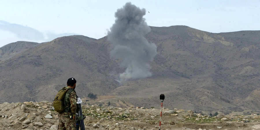 Smoke rises after an air strike by US aircraft on positions during an ongoing an operation against Islamic State (IS) militants in Kot district of Nangarhar province on February 16, 2017. Afghan National Army (ANA) and international air forces have launched a joint military operation against Islamic State (IS) militants, after houses of locals were torches and several people were killed by IS fighters in the area, so far in the operation at least 52 armed insurgents have been killed and 18 others wounded, security force officials said. / AFP / NOORULLAH SHIRZADA (Photo credit should read NOORULLAH SHIRZADA/AFP/Getty Images)