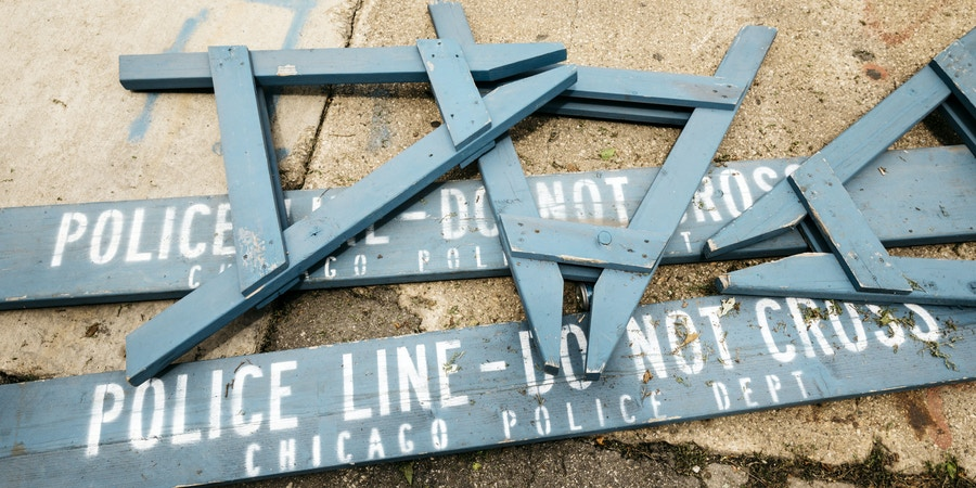 Chicago, IL - July 13, 2017 - Police barricades lie in a pile one block from