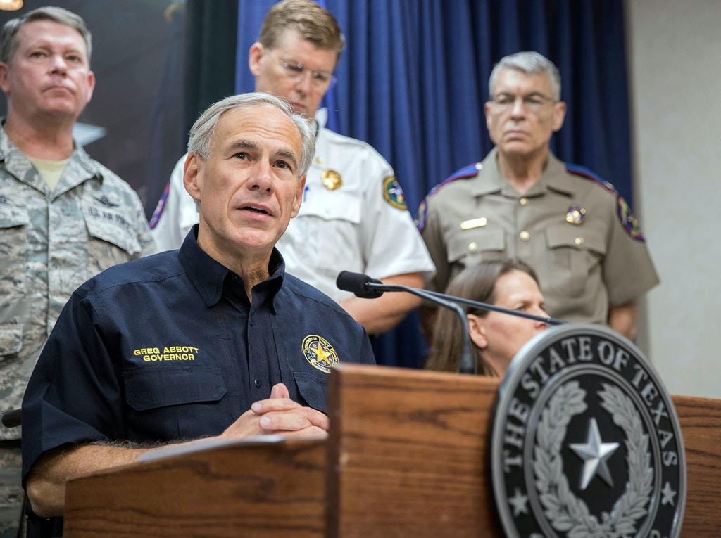 "FILE- In this Aug. 30, 2017, file photo, Texas Gov. Greg Abbott speaks during a press briefing the State of Texas Emergency Command Center at Department of Public Safety headquarters in Austin, Texas. A federal judge late Wednesday temporarily blocked most of Texas' tough new ""sanctuary cities"" law that would have let police officers ask people during routine stops whether they're in the U.S. legally and threatened sheriffs will jail time for not cooperating with federal immigration authorities. Abbott, who signed the law in May, said Texas would appeal immediately and expressed confidence that the state would eventually prevail. (Ricardo B. Brazziell/Austin American-Statesman via AP, File)"