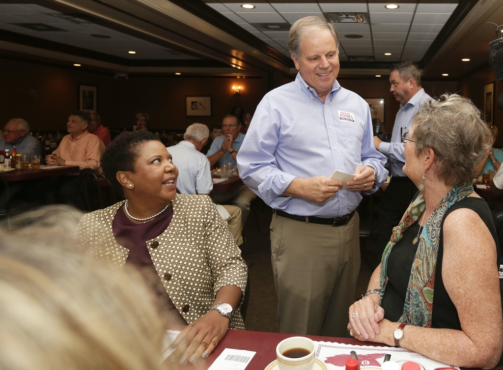 Democratic Senate nominee Doug Jones, center, talks to supporters, Jennifer L. Greer, right, and Janet Crosby, left, as he campaigns at Niki's West restaurant, Wednesday, Sept. 27, 2017, in Birmingham, Ala. Jones will face former Alabama Chief Justice and U.S. Senate candidate Roy Moore. (AP Photo/Brynn Anderson)