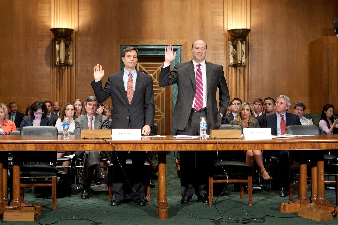Gary Cohn, president and chief operating officer of Goldman Sachs Group Inc., right, and Craig Broderick, managing director and head of credit, market and operational risk with Goldman Sachs, are sowrn in during a Financial Crisis Inquiry Commission hearing on the role of derivatives in the financial crisis in Washington, D.C., U.S., on Wednesday, June 30, 2010. Goldman Sachs bought protection against a decline in just 1 percent of the mortgage backed securities the company underwrote since late 2006, according to Cohn. Photographer: Andrew Harrer/Bloomberg via Getty Images