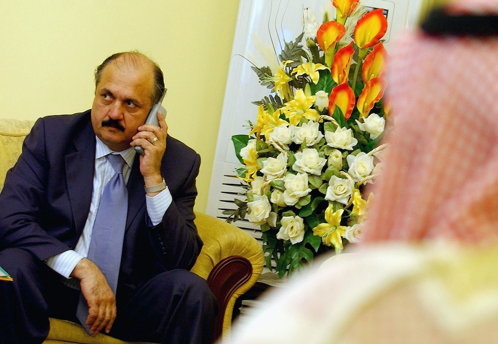 BAGHDAD, IRAQ - APRIL 2:  Sunni Arab member of Iraqi Transitional National Assembly (TNA) and a candidate for the post of parliament speaker Meshaan al-Jubouri speaks on the phone April 2, 2005 in Baghdad, Iraq. Iraqi Transitional National Assembly will hold its third-ever session on April 3, 2005 after it failed Tuesday to agree on a parliament speaker. The TNA tries to choose a Sunni Arab speaker for the assembly a step officials hope will quell the Sunni-led insurgency. (Photo by Wathiq Khuzaie/Getty Images)