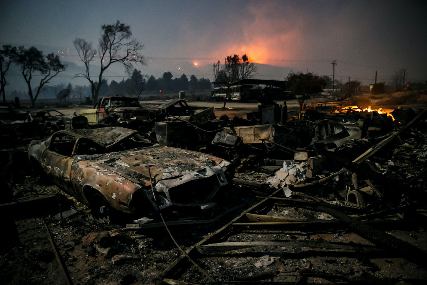SAN BERNARDINO, CA - AUGUST 18: Burned vehicles sit in the glow of the full moon on Highway 138 in Phelan as the Blue Cut fire continues to ravage San Bernardino County, Calif., on Aug. 18, 2016. (Photo by Marcus Yam/Los Angeles Times via Getty Images)