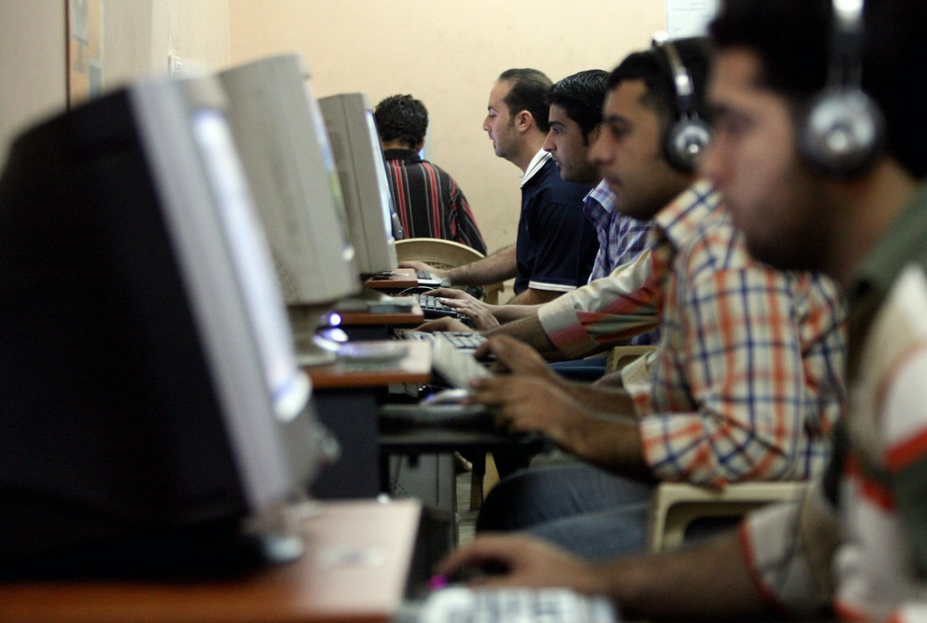 Iraqi youth surf the web at an internet cafe in Baghdad's impoverished district of Sadr city, 15 November 2007. Iraqi youth are spending more time on the internet; following local and international news or chatting with far away friends as they try to escape their bitter reality by staying in connection with the outside world through the virtual world of the internet. AFP PHOTO/ALI AL-SAADI (Photo credit should read ALI AL-SAADI/AFP/Getty Images)