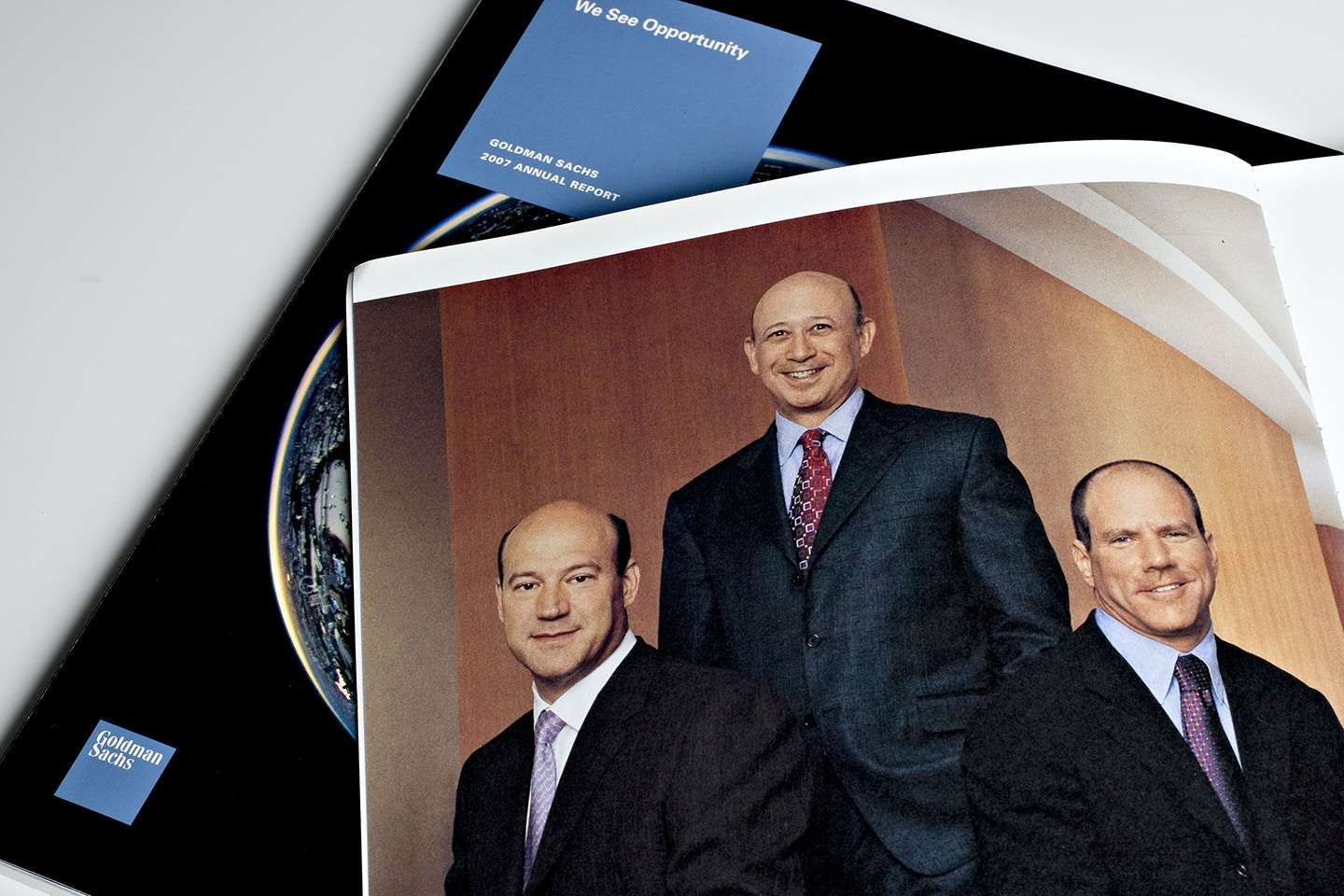 UNITED STATES - JUNE 16:  The Goldman Sachs Group Inc. executives, from right, Gary Cohn, president and co-chief operating officer, Lloyd Blankfein, chairman and chief executive officer, and Jon Winkelreid, president and co-chief operating officer, appear in a 2006 annual report arranged for a photograph in New York, U.S., on Monday, June 16, 2008. A 2007 annual report sits at left.  (Photo by Daniel Acker/Bloomberg via Getty Images)
