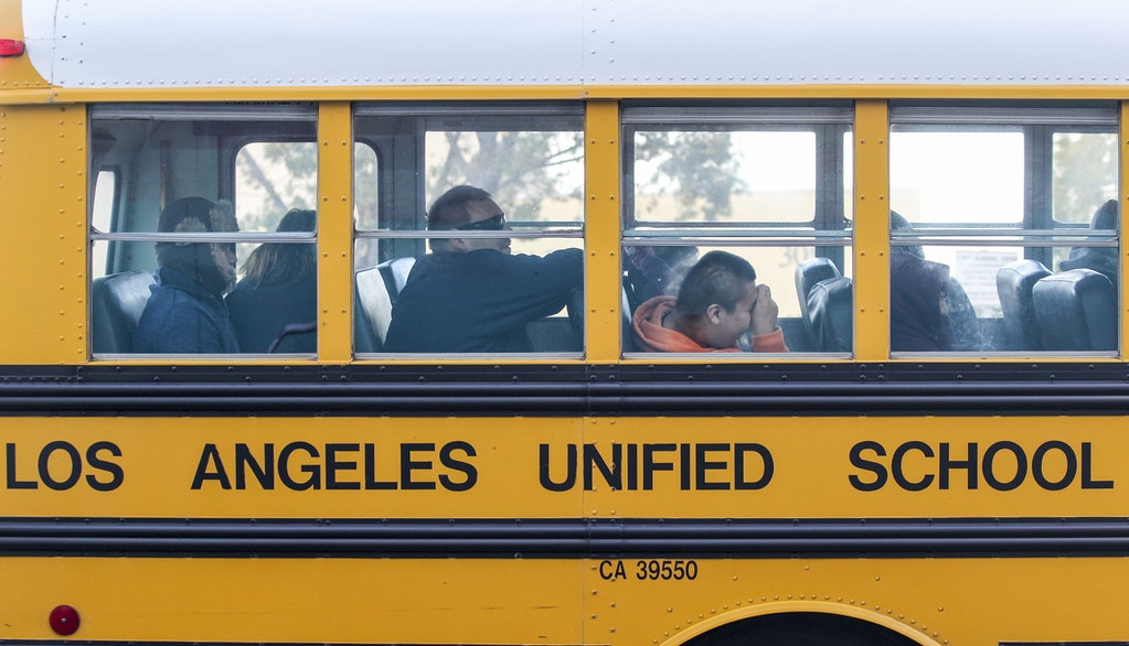 A school bus arrives at a school in Los Angeles on December 16, 2015. Responding to a threat emailed to school board members, all Los Angeles Unified School District campuses were closed on December 15 and authorities conducted an exhaustive search of more than 1,500 school sites, but the threat was found not to be credible. AFP PHOTO/RINGO CHIU / AFP / RINGO CHIU        (Photo credit should read RINGO CHIU/AFP/Getty Images)