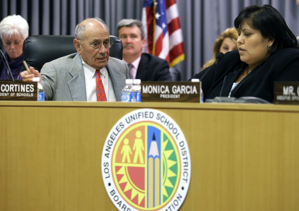 Los Angeles Unified School District Superintendent Ramon Cortines, left, and Board of Education president Monica Garcia, right, agree with board members who decided to delay a vote on layoffs at their headquarters in Los Angeles on Tuesday, March 31, 2009. The Los Angeles Board of Education has put off a vote on whether to lay off thousands of teachers and other workers because of a huge budget deficit in the nation's second-largest school district. (AP Photo/Damian Dovarganes)