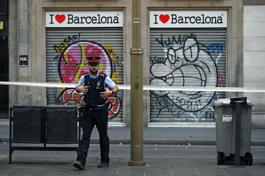 BARCELONA, SPAIN - AUGUST 18: A police officer patrols on Las Ramblas following yesterday's terrorist attack, on August 18, 2017 in Barcelona, Spain. Thirteen people were killed and dozens injured when a van hit crowds in the Las Ramblas area of Barcelona on Thursday. Spanish police have also killed five suspected terrorists in the town of Cambrils to stop a second terrorist attack.  (Photo by Carl Court/Getty Images)