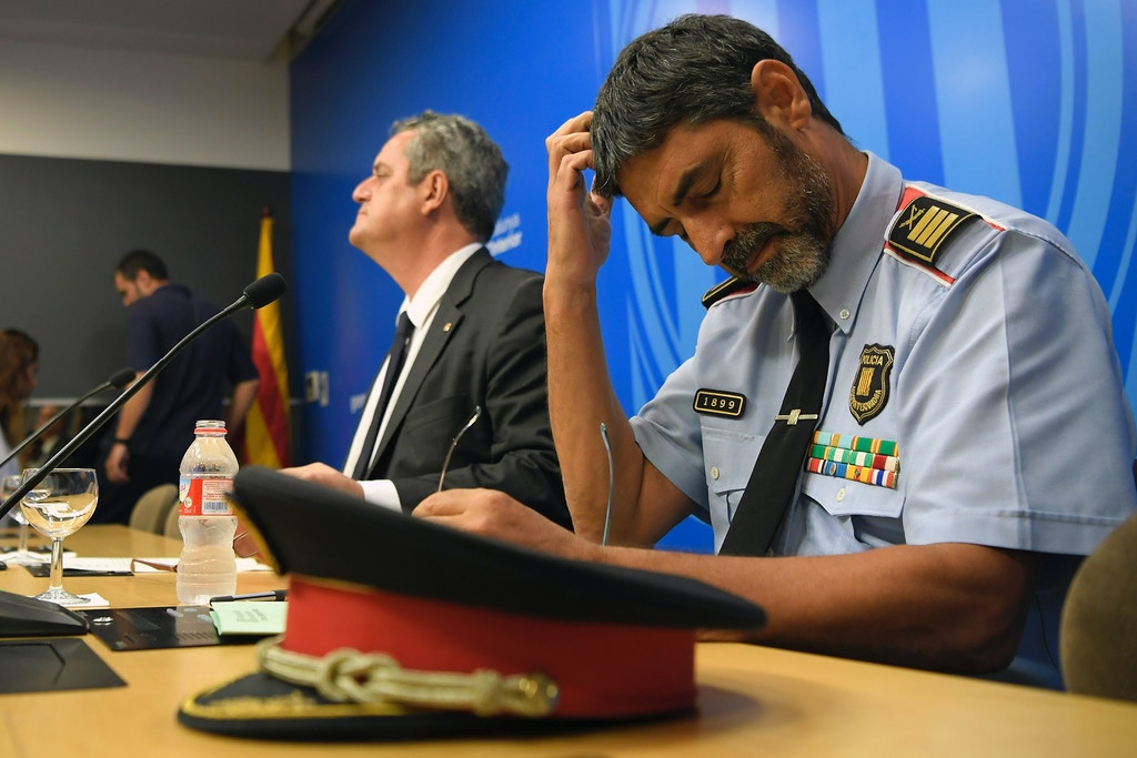 "Josep Lluis Trapero, chief of the Catalan regional police ""Mossos D'Esquadra"" (R) and Interior Minister for the Catalan government Joaquim Forn (L) give a press conference in Barcelona on August 31, 2017.<br /> US security agencies warned Spain in May that the Islamic State group was planning an attack in Barcelona, where the jihadists claimed a deadly van rampage earlier this month, local media said on August 31, 2017. The daily El Periodico de Cataluna reported that the US National Counterterrorism Center (NCTC) alerted Spanish intelligence officers to the threat weeks before a man ploughed his vehicle into crowds of tourists along Barcelona's Las Ramblas boulevard on August 17, killing 14 people. / AFP PHOTO / LLUIS GENE        (Photo credit should read LLUIS GENE/AFP/Getty Images)"