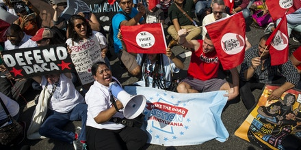 WASHINGTON, DC - SEPTEMBER 5:  Demonstrators sit on Pennsylvania Avenue during a demonstration in response to the Trump Administration's announcement that it would end the Deferred Action for Childhood Arrivals (DACA) program on September 5, 2017 in Washington, DC.  DACA, an immigration policy passed by former President Barack Obama, allows certain undocumented immigrants who arrived in the United States as minors to receive renewable two-year deferred action from deportation and eligibility fork a work permit. (Photo by Zach Gibson/Getty Images)