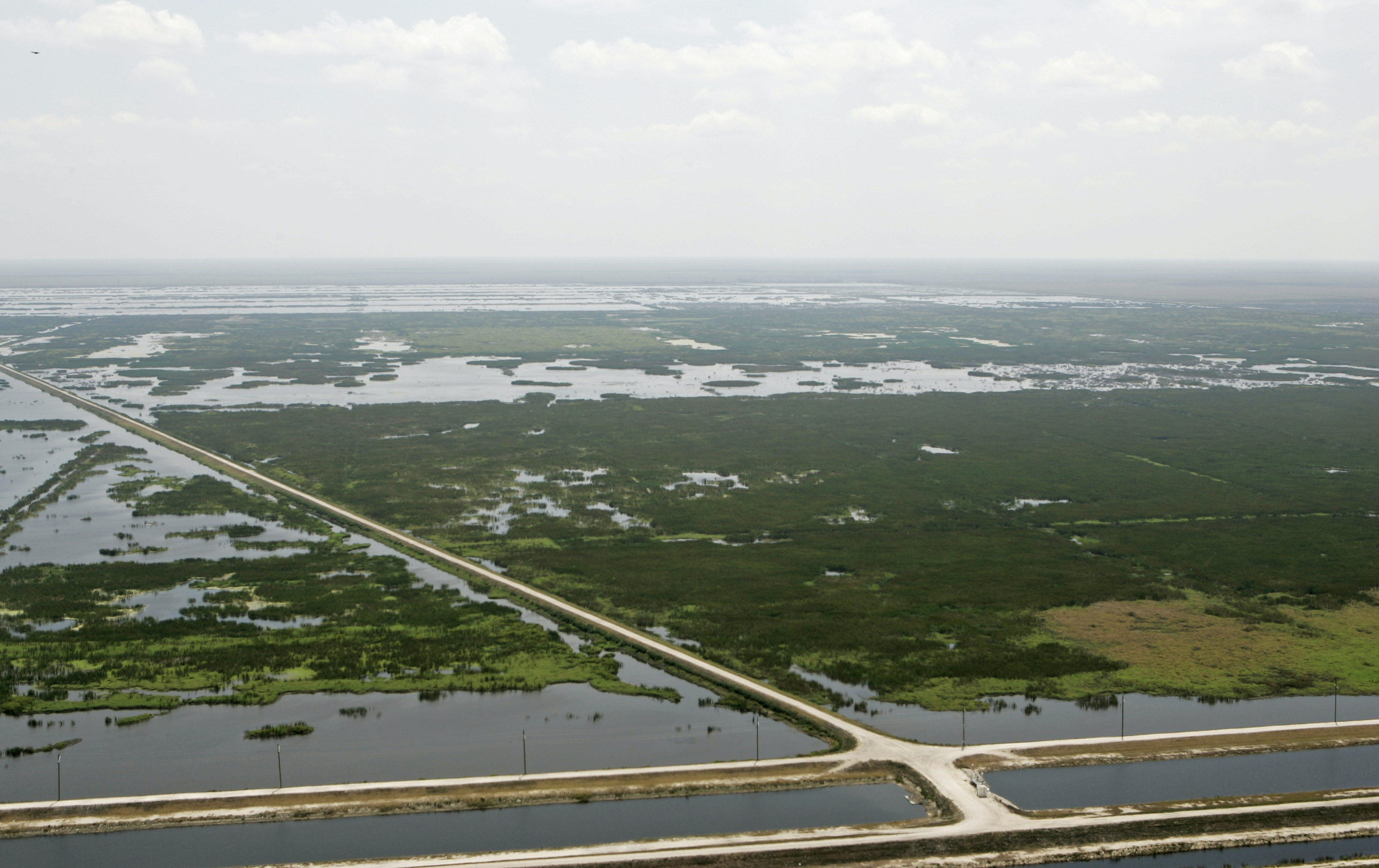** APN ADVANCE FOR SUNDAY, MAY 28 **An overhead view of the Florida Everglades Tuesday, April 4, 2006 in the Palm Beach County area of the Everglades, Fla. In Florida, where the Everglades has become a managed network of canals and levees, scientists are facing the daunting task of managing more water from frequent storms to keep developed areas from flooding and to cleanse agricultural runoff of fertilizers and pesticides before it bleeds into surrounding wetlands. (AP Photo/Alan Diaz)
