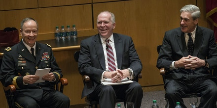 NEW YORK, NY - AUGUST 08:  General Keith B. Alexander, Director of the National Security Agency (NSA) and Commander of U.S. Cyber Command (L); John O. Brennan, Director of the Central Intelligence Agency (CIA) (C); and Robert S. Mueller III, Director of the Federal Bureau of Investigation (FBI) (R), take part in a question-and-answer forum during the International Conference on Cyber Security (ICCS) on August 8, 2013 in New York City. The ICCS, which is co-hosted by Fordham University and the FBI, is held every 18 months; more than 25 countries are represented at this year's conference.  (Photo by Andrew Burton/Getty Images)