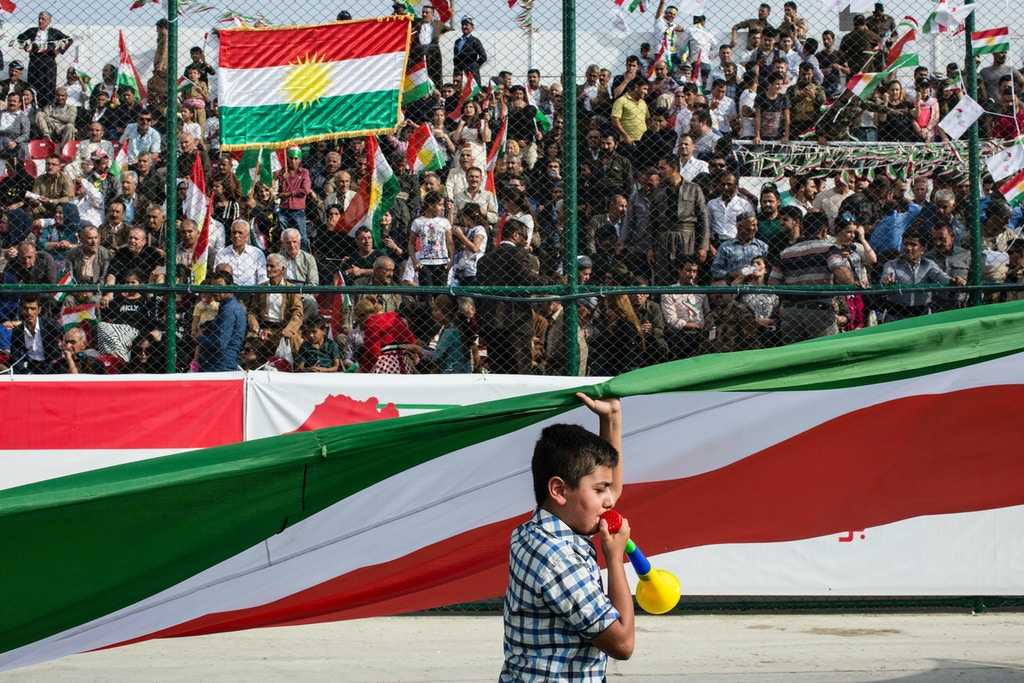 SULAIMANIYAH, IRAQ: A young boy runs around the Sulaimaniyah Stadium carrying a Kurdish flag during a pro-independence rally.Iraqi Kurdish president, Masoud Barzani, has called for a referendum on Kurdish independence for September 25th. It is opposed by the central Iraqi government and many external countries including the US.Photo by Sebastian Meyer