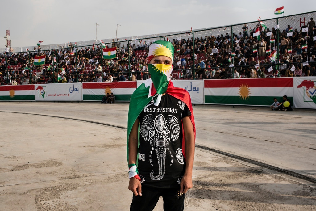 SULAIMANIYAH, IRAQ: A young man dressed in the Kurdish flag at the Sulaimaniyah Stadium during a pro-independence rally.Iraqi Kurdish president, Masoud Barzani, has called for a referendum on Kurdish independence for September 25th. It is opposed by the central Iraqi government and many external countries including the US.Photo by Sebastian Meyer