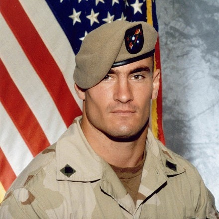 ** FILE ** Cpl. Pat Tillman is seen in a this 2003 file photo provided by Photography Plus. Just seven days after Pat Tillman's death, a top general warned there were strong indications that it was friendly fire and President Bush might embarrass himself if he said the NFL star-turned-soldier died in an ambush, according to a memo obtained by The Associated Press.  (AP Photo/Photography Plus via Williamson Stealth Media Solutions, FILE)