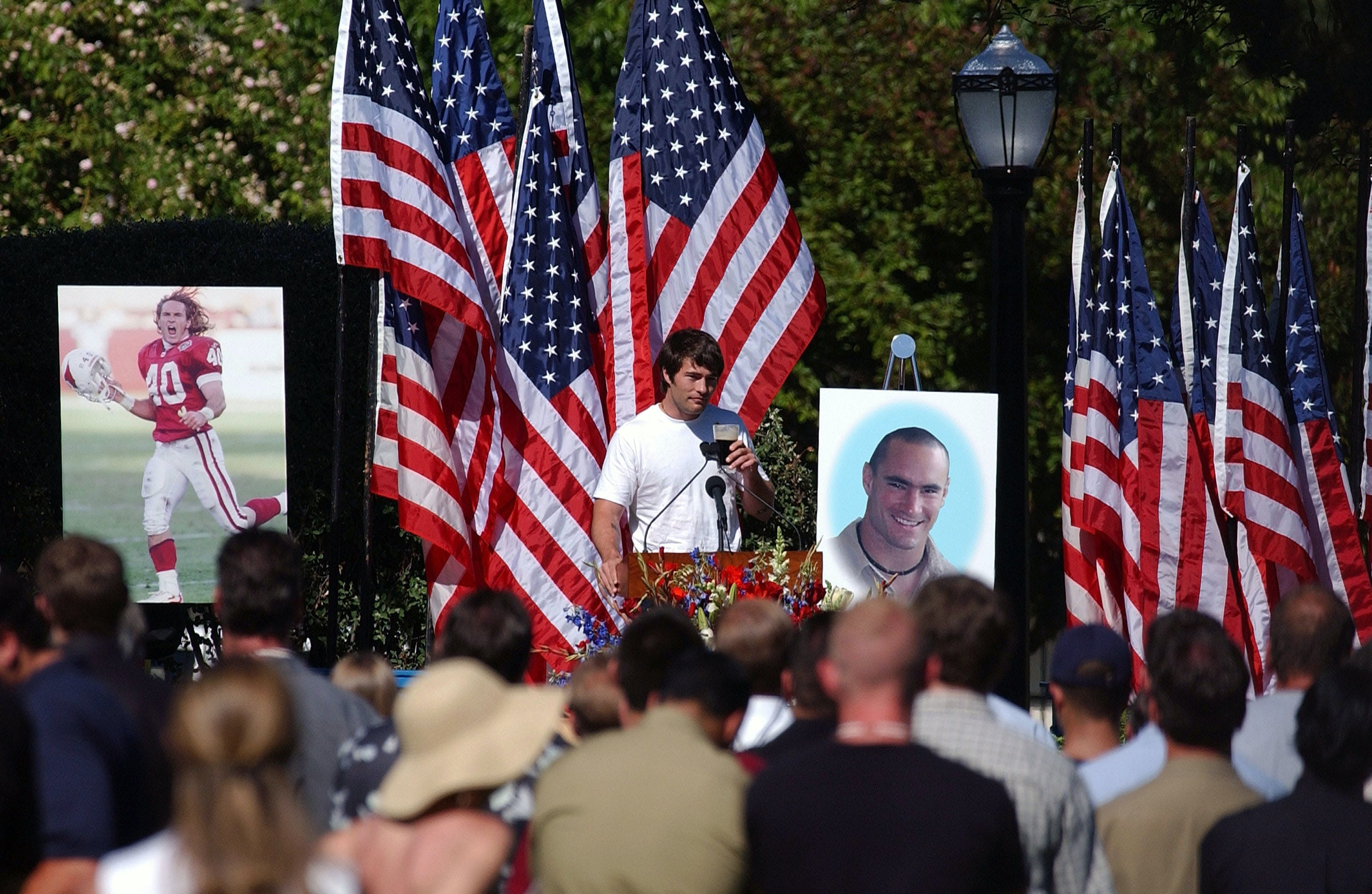 SAN JOSE, CA - MAY 3:  Richard Tillman, the brother of  Cpl. Pat Tillman, raises a toast with a glass of Guiness, as he speaks at a memorial service for his Tillman, who was killed in action in Afghanistan April 22, 2004, at the San Jose Municipal Rose Garden May 3, 2004 in San Jose, California.  Tillman turned down a lucrative NFL contract to serve with as a US Army Ranger.  (Photo by David Paul Morris/Getty Images)