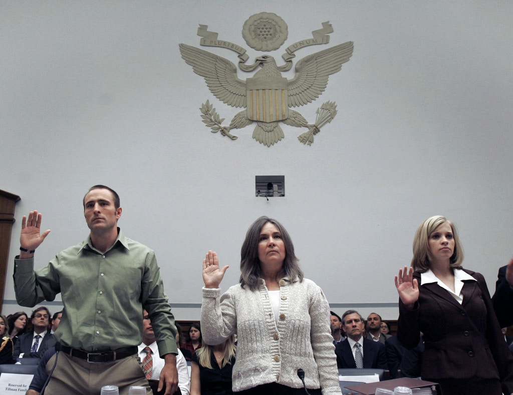 Kevin Tillman, left, brother of former NFL star and Army Ranger Pat Tillman, who was killed by friendly-fire in Afghanistan, his mother Mary Tillman, center, and former Iraq POW Jessica Lynch, right, are sworn in prior to testifying before the House Oversight and Government Reform hearing on Capitol Hill, Tuesday, April 24, 2007. (AP Photo/Susan Walsh)
