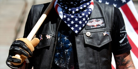 A right-wing demonstrator participates in the Denver March Against Sharia Law in Denver, Colorado on June 10, 2017. The march was supported by two right-wing groups, The Proud Boys, and Bikers Against Radical Islam. Police kept the counter protestors separated during the rally which was held in front of the Colorado State Capital. The march was one of many held throughout the U.S. opposing Sharia law, and was viewed by many as promoting both Islamophobia and racism. / AFP PHOTO / Jason Connolly        (Photo credit should read JASON CONNOLLY/AFP/Getty Images)