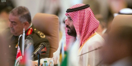 In this photo released by the state-run Saudi Press Agency, Saudi Crown Prince Mohammed bin Salman speaks at a meeting of the Islamic Military Counterterrorism Alliance in Riyadh, Saudi Arabia, Sunday, Nov. 26, 2017. Saudi Arabia's assertive crown prince on Sunday opened the first high-level meeting of a kingdom-led alliance of Muslim nations against terrorism, vowing that extremists will no longer