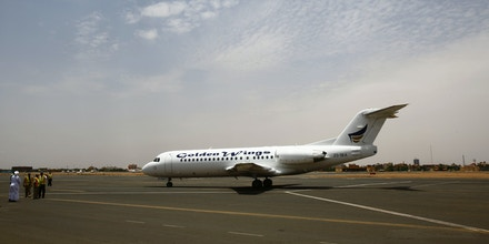 A Golden Wings aeroplane transporting Sudanese citizens arrives at the airport in Khartoum from Juba on July 15, 2016 as Sudan began evacuating its nationals from South Sudan, following fresh fighting in the South Sudanese capital ahead of the country's independence anniversary.The last in the city of Juba Sunday noon July 15, 2016South Sudanese voted for independence from Sudan under a peace agreement in 2011 but the world's youngest country fell into a civil war that has killed tens of thousands of people. Specially chartered planes have been taking foreign nationals out of the country since July 13. Sudan too began evacuating its nationals, and the first flight carrying 76 Sudanese arrived in Khartoum on July 15. / AFP / ASHRAF SHAZLY (Photo credit should read ASHRAF SHAZLY/AFP/Getty Images)