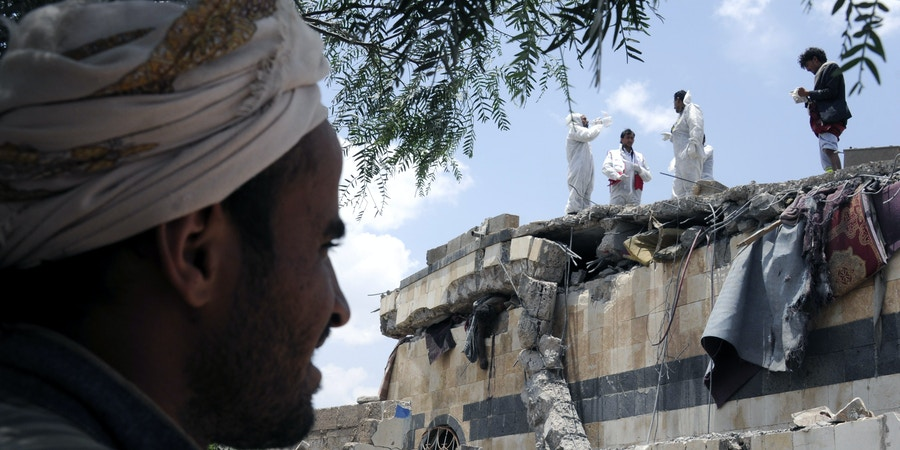 SANAA, YEMEN - AUGUST 23: (EDITORS NOTE: Image contains graphic content) People search for survivors and death bodies at a heavily damaged building after Saudi-led coalition's air strikes over Arhab District of Sanaa, Yemen on August 23, 2017. At least 20 Shia Houthi militia group members were killed due to the attack. (Photo by Mohammed Hamoud/Anadolu Agency/Getty Images)