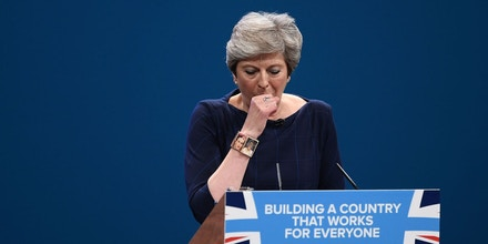 MANCHESTER, ENGLAND - OCTOBER 04:  British Prime Minister Theresa May struggles with a cough as she delivers her keynote speech to delegates and party members on the last day of the Conservative Party Conference at Manchester Central on October 4, 2017 in Manchester, England. The prime minister rallied members and called for the party to