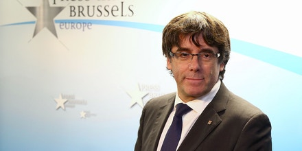Catalonia's dismissed leader Carles Puigdemont along with other members of his dismissed government arrives to address a press conference at The Press Club in Brussels on October 31, 2017.Puigdemont, dismissed by the Spanish government on October 27 after Catalonia's parliament declared independence, reportedly drove hundreds of kilometres (miles) to Marseille in France and then flew to Belgium. / AFP PHOTO / Aurore BELOT (Photo credit should read AURORE BELOT/AFP/Getty Images)