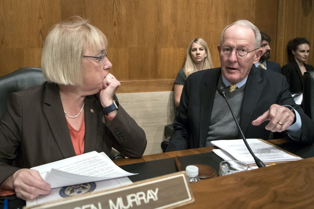 Sen. Patty Murray, D-Wash., the ranking member, and Sen. Lamar Alexander, R-Tenn., chairman of the Senate Health, Education, Labor, and Pensions Committee, meet before the start of a hearing on Capitol Hill in Washington, Wednesday, Oct. 18, 2017. (AP Photo/J. Scott Applewhite)
