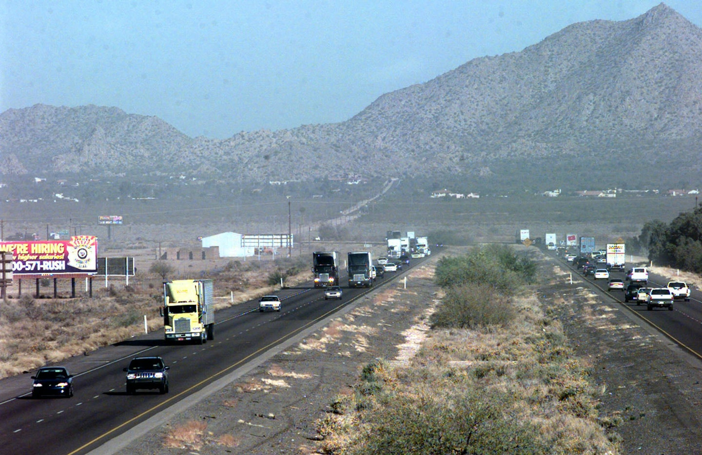 Traffic travels on Interstate 10 east of Casa Grande, Ariz., on Thursday, Dec. 23, 1999. The state Department of Transportation plans to eventually widen the interstate all the way from Phoenix to Tucson. But at least one Casa Grande businessman who relies on the highway for a living thinks the plan may become outdated, even before construction could begin. (AP Photo/Francisco Medina)