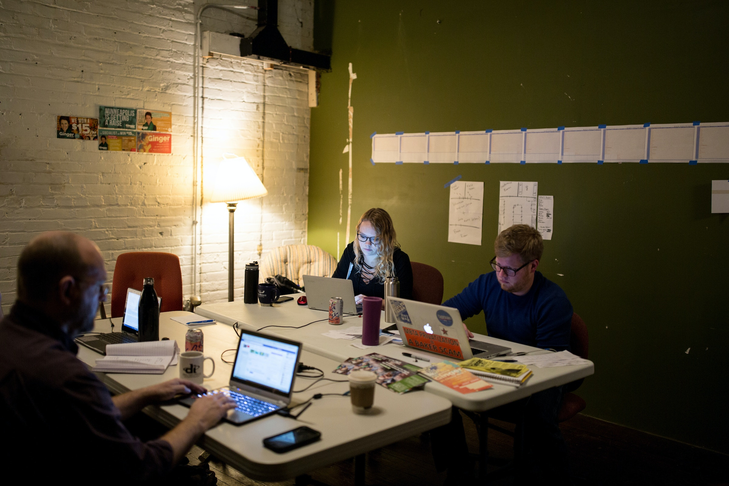 Kelly Bellin and Andy Moxley, right, work on Ginger Jentzen's campaign in  the campaign