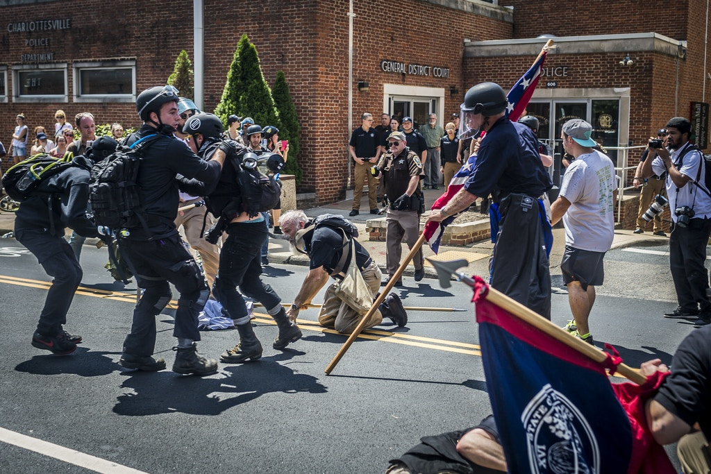 "Full-on fighting occurred in front of the Charlottesville Police Station. All the officers stood by and watched, never arresting or stopping the violence throughout the entire day. On Saturday, August 12, 2017, a veritable who's who of white supremacist groups clashed with hundreds of counter-protesters during the ""Unite The Right"" rally in Charlottesville, Va. Dozens were injured in skirmishes and many others after a white nationalist plowed his sports car into a throng of protesters. One counter-protester died after being struck by the vehicle. The driver of the car was caught fleeing the scene and the Governor of Virginia issued a state of emergency. (Photos by Michael Nigro)(Sipa via AP Images)"