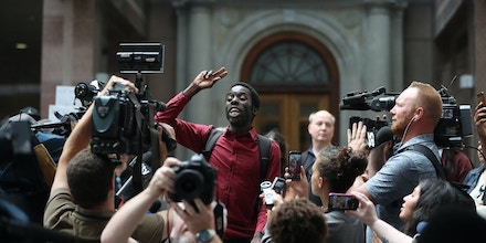 TORONTO, ON- AUGUST 24  -   Desmond Cole addresses  a group of activists and protesters outside of police headquarters. Police board meeting had several interruption as protesters an activists pressured the board for answers at Police Headquarters in Toronto.        (Steve Russell/Toronto Star via Getty Images)