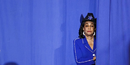 Representative Frederica Wilson, a Democrat from Florida, looks from behind a curtain during a campaign event for Hillary Clinton, presumptive 2016 Democratic presidential nominee, not pictured, in Miami, Florida, U.S., on Saturday, July 23, 2016. Clinton named Virginia Senator Tim Kaine as her running mate for the Democratic presidential ticket, a widely-anticipated choice that may say more about how she wants to govern than how she plans to win in November. Photographer: Patrick T. Fallon/Bloomberg via Getty Images