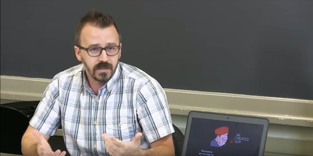 This video still frame shows Drexel University associate professor George Ciccariello-Maher giving a lecture at Mario Einaudi Center for International Studies at Cornell University.