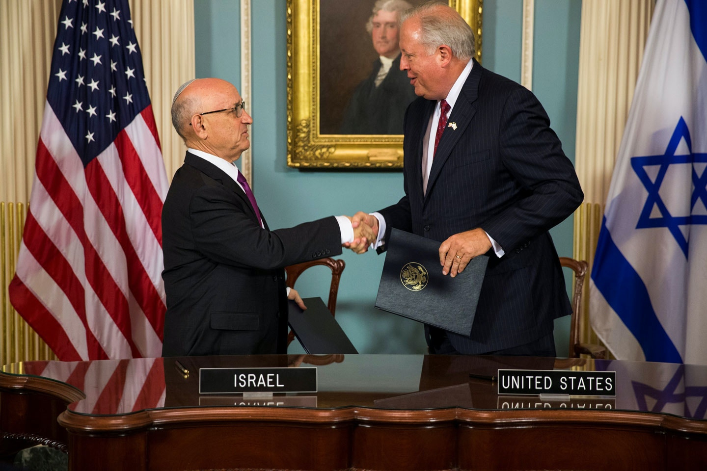 WASHINGTON, USA - SEPTEMBER 14 :  Jacob Nagel (L), Israel's acting National Security Advisor, and Tom Shannon (R), U.S. Undersecretary of State, exchange the agreements during a signing ceremony for the new 10-year defense assistance pact between the US and Israel at the Department of State in Washington, USA on September 14, 2016. (Photo by Samuel Corum/Anadolu Agency/Getty Images)
