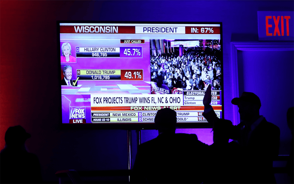 People cheer as voting results for Wisconsin come in at Republican presidential nominee Donald Trump's election night event at the New York Hilton Midtown on November 8, 2016 in New York City.