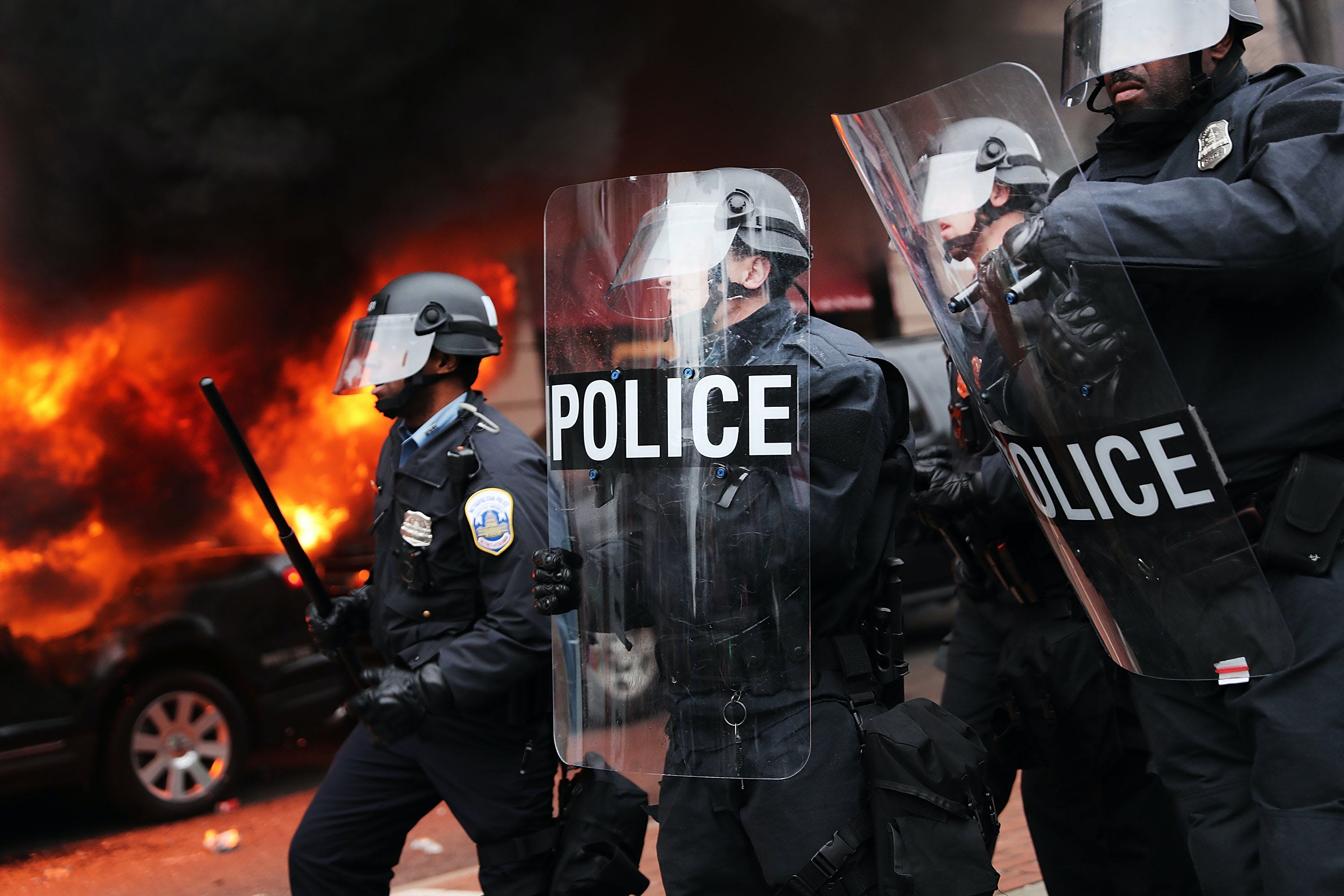 WASHINGTON, DC - JANUARY 20: Police and demonstrators clash in downtown Washington after a limo was set on fire following the inauguration of President Donald Trump on January 20, 2017 in Washington, DC. (Photo by Spencer Platt/Getty Images)