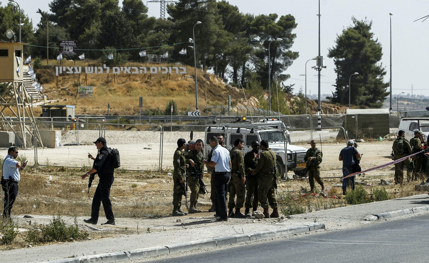 Israeli forensic policemen inspect the place where a 24-year-old Palestinian attempted to stab Israeli soldiers and was shot dead by security forces, at the Gush Etzion junction, a settlement bloc next to the biblical Palestinian town of Bethlehem on July 28, 2017.Israeli-Palestinian tensions have been high over the last couple weeks due to a dispute over the sensitive Al-Aqsa mosque compound in Jerusalem, also known as the Haram al-Sharif or to Jews as the Temple Mount, but it was unclear if there was any link. / AFP PHOTO / Musa AL SHAER (Photo credit should read MUSA AL SHAER/AFP/Getty Images)