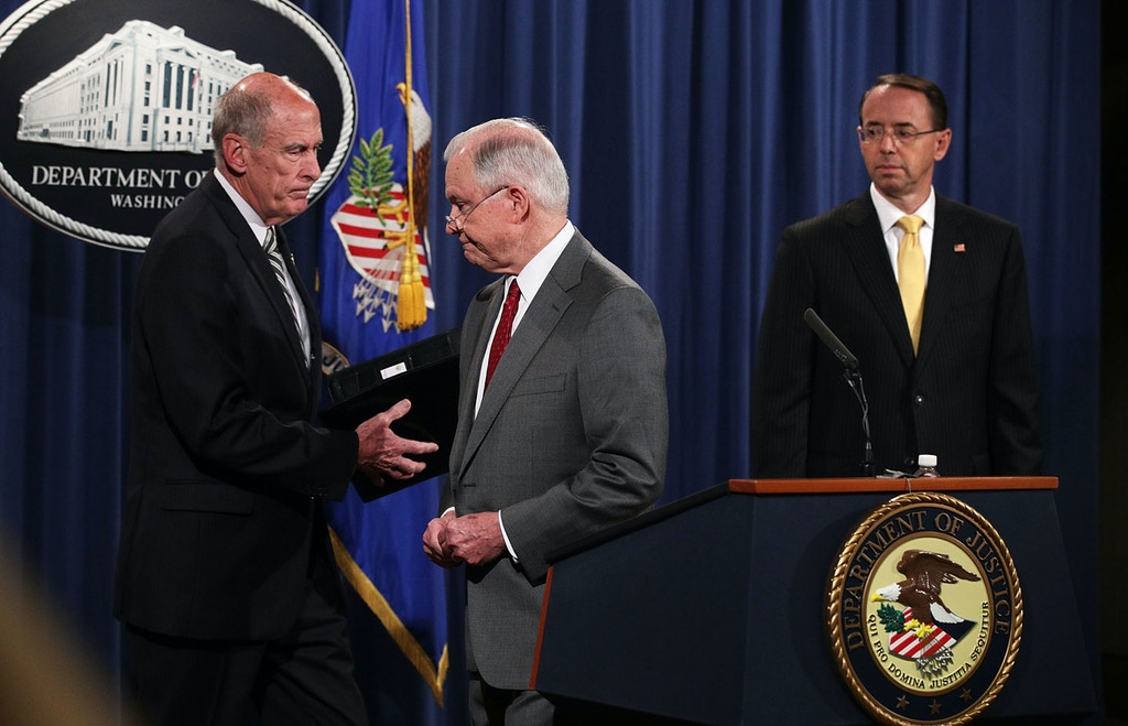 "WASHINGTON, DC - AUGUST 04:  (L-R) U.S. Director of National Intelligence Dan Coats, Attorney General Jeff Sessions, and Deputy Attorney General Rod Rosenstein attend an event at the Justice Department August 4, 2017 in Washington, DC. Sessions held the event to discuss ""leaks of classified material threatening national security.""  (Photo by Alex Wong/Getty Images)"