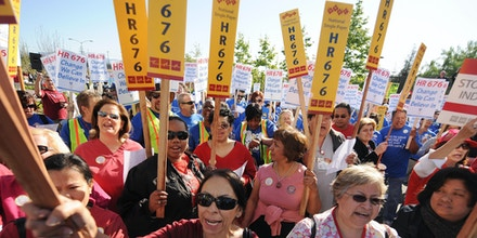 Nurses and other healthcare activists rally for single-payer/universal healthcare and against any proposed bailouts of private health insurance corporations on April 06, 2009 in Los Angeles.  The activists are calling for the passage of HR 676, the United States National Health Insurance Act which would create a universal single-payer health care system, in which the government would provide every resident health care free of charge.    AFP PHOTO / Robyn BECK (Photo credit should read ROBYN BECK/AFP/Getty Images)