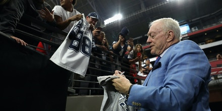 GLENDALE, AZ - SEPTEMBER 25:  Dallas Cowboys owner Jerry Jones signs autographs before the start of the NFL game against the Arizona Cardinals at the University of Phoenix Stadium on September 25, 2017 in Glendale, Arizona.  (Photo by Christian Petersen/Getty Images)