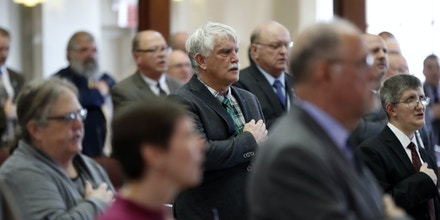 State representatives recite the Pledge of Allegiance as the Maine Legislature reconvenes Wednesday, Jan. 4, 2017, at the State House in Augusta, Maine.  (AP Photo/Robert F. Bukaty)